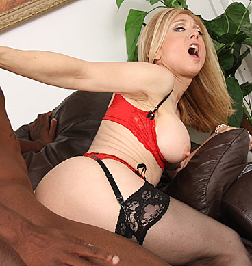 Busty Nina Hartley goes black in sexy stockings and lingerie from Blacks on Cougars